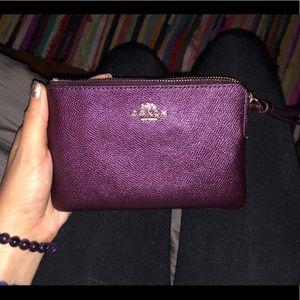 Purple/maroon Coach wallet